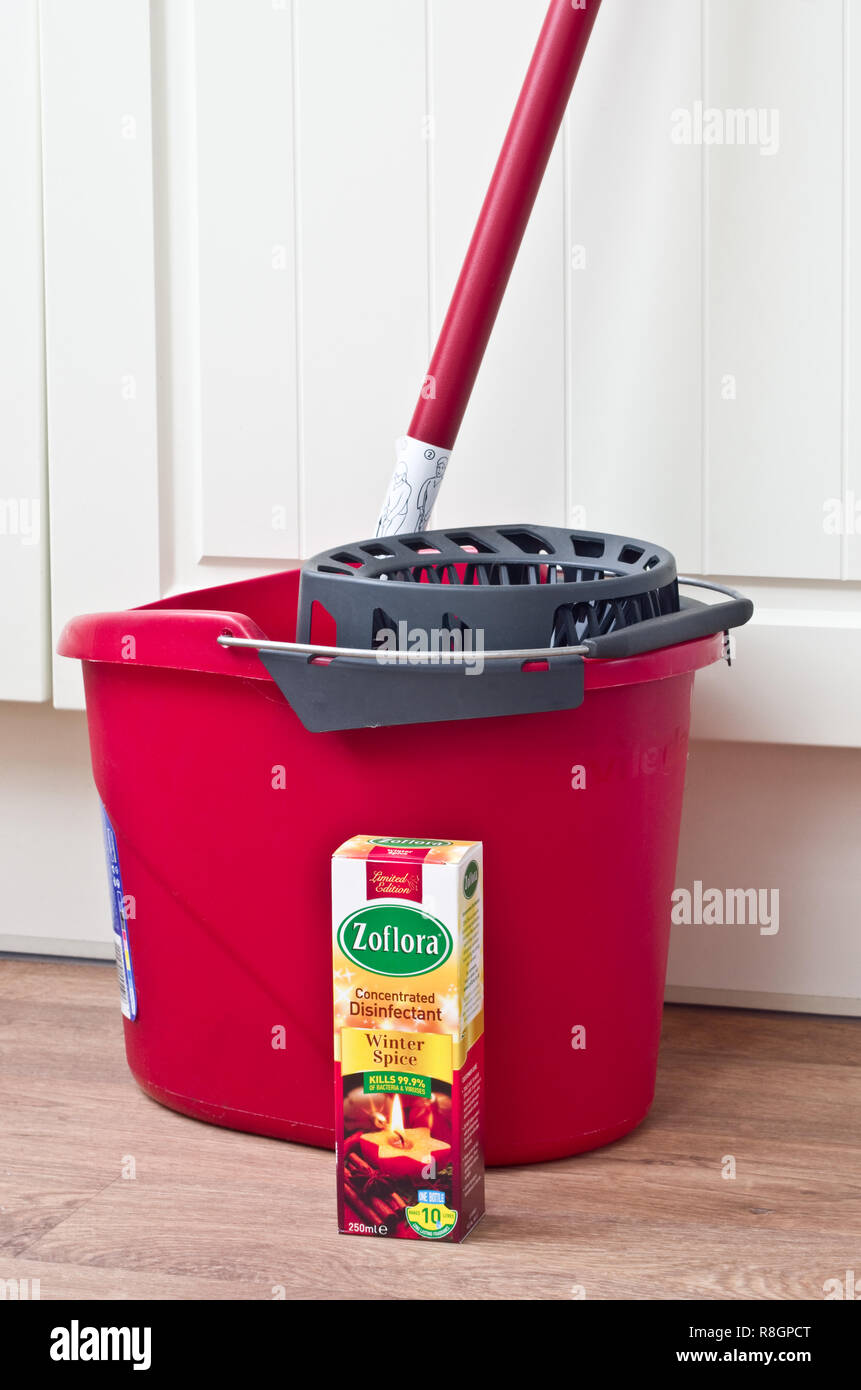 Zoflora Concentrated Disinfectant & Plastic Mop and Bucket in a Home Environment, UK Stock Photo