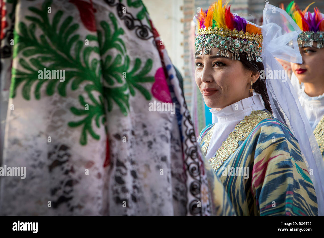 woman, folk dancers, in traditional costume, dress, suit, in Rukhobod Mausoleum, Samarkand, Uzbekistan Stock Photo