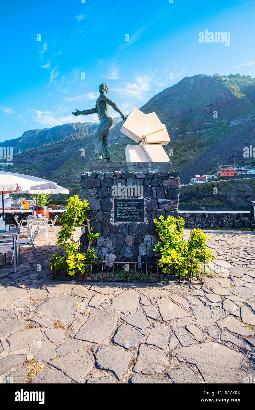 Garachico the oldest port city of Tenerife a small town with a great history - the monument of a Canarian emigrant. - Stock Image