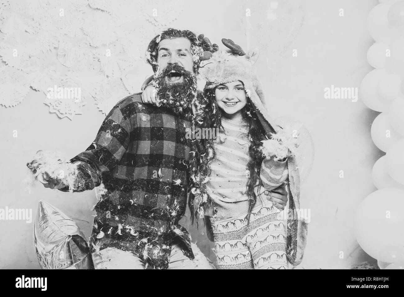 Father and daughter playing, celebrating and having fun on eve of Christmas or New Year - Stock Image