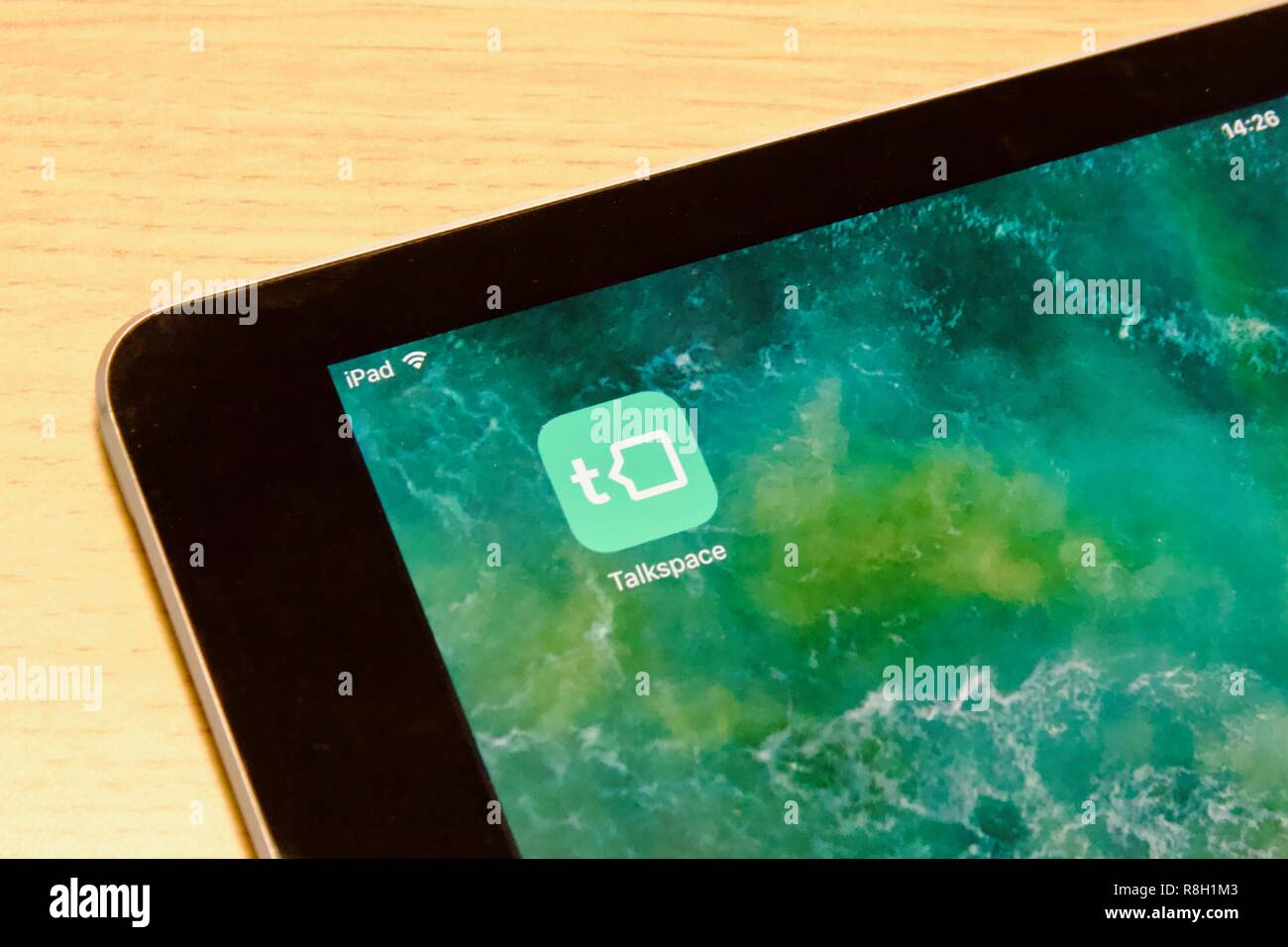 Talkspace app on an iPad Air, providing online therapy and counselling - Stock Image