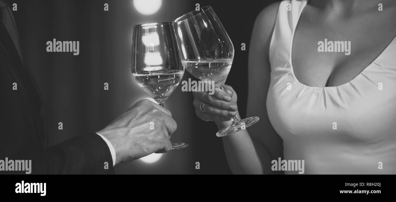 toast of couple clink glasses with white wine - Stock Image