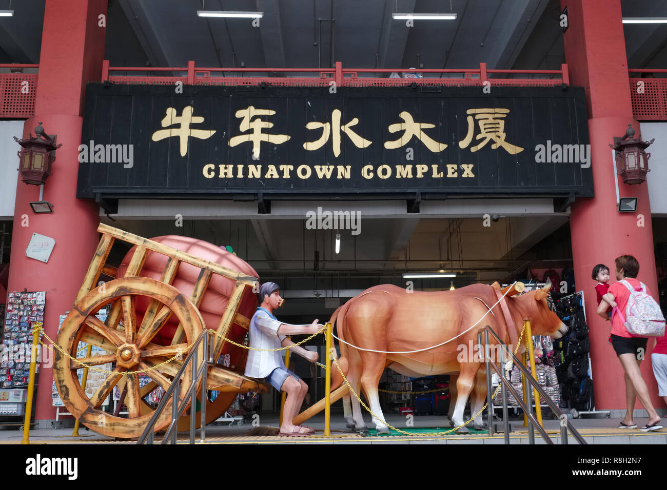 Depiction of an old-time bullock cart at Chinatown Complex, a shopping center in Chinatown, Singapore - Stock Image