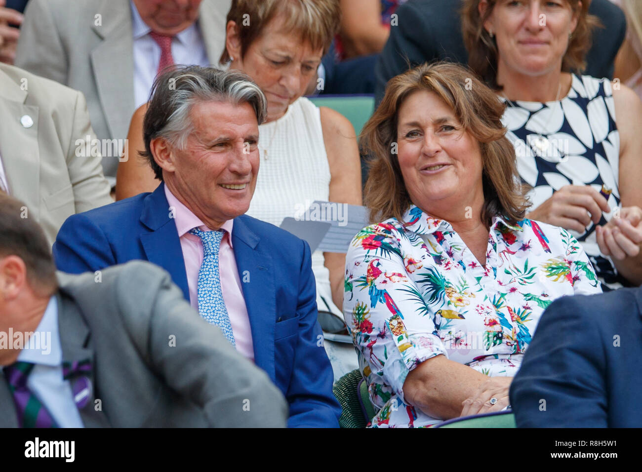 President of the International Association of Athletics Federations Seb Coe watches the action during the Wimbledon Championships 2019 - Stock Image