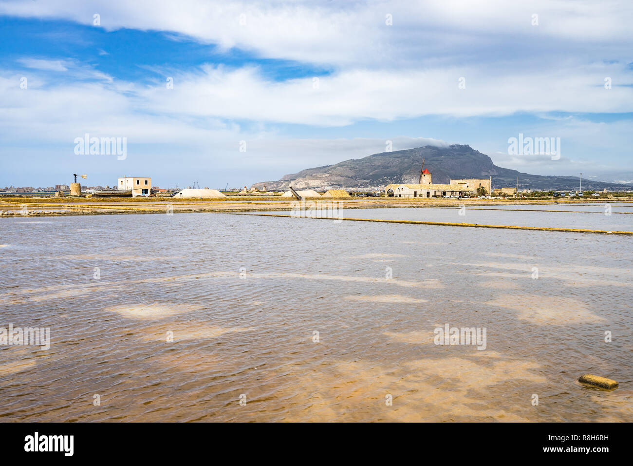 Amazing landscape of Trapani saline with windmills and Mount Erice in the background, Sicily, Italy Stock Photo
