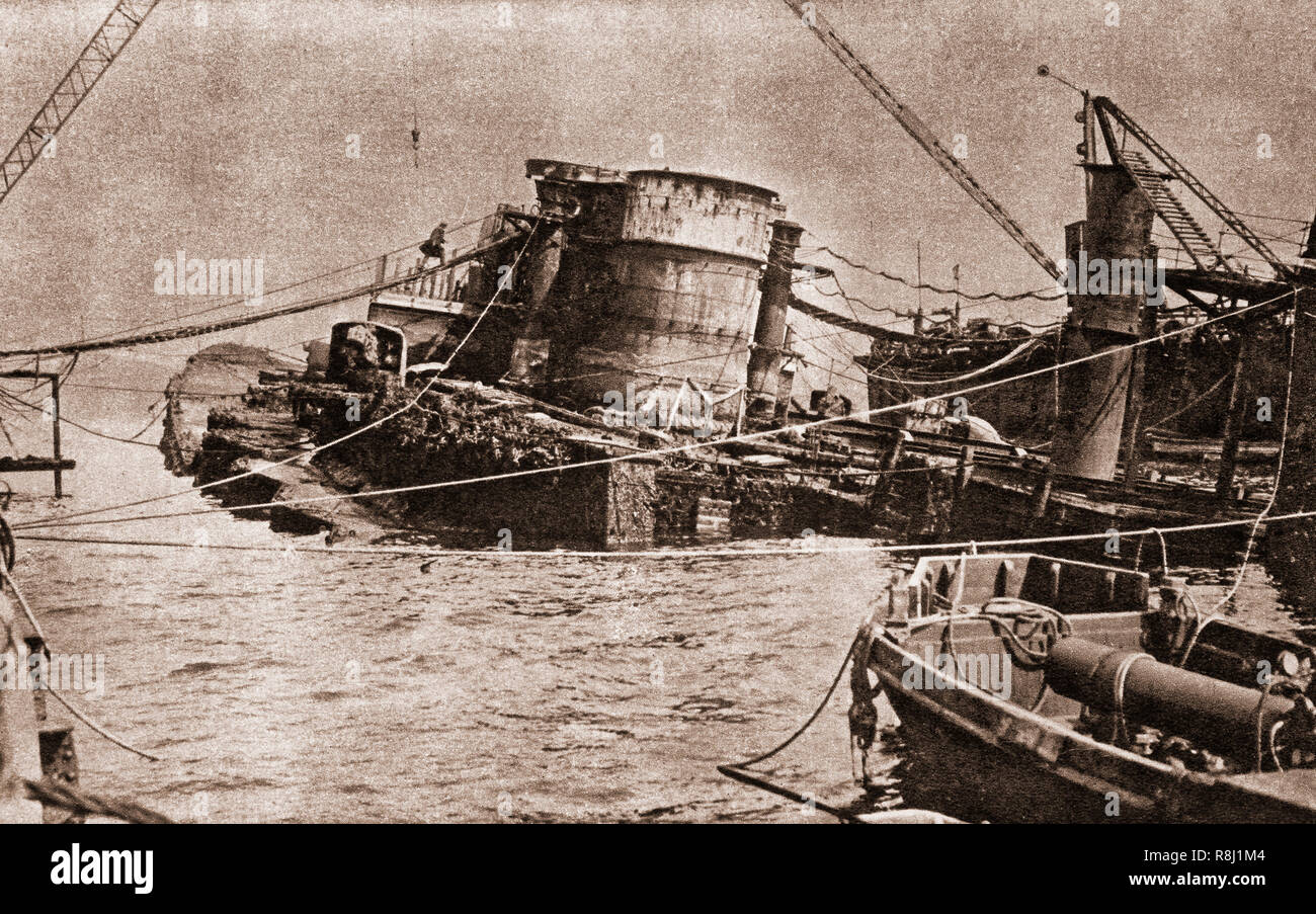 The scuttling of the German fleet carried out on 21 June 1919 took place at the Royal Navy's base at Scapa Flow in the Orkney Islands, Scotland, after the First World War. The High Seas Fleet was interned there under the terms of the Armistice whilst negotiations took place over the fate of the ships, but Admiral Ludwig von Reuter decided to scuttle the fleet, however British guard ships beached 22 of the 74 interned vessels. The photograph illustrates one of the many wrecks were salvaged over the next two decades and were towed away for scrapping. Stock Photo