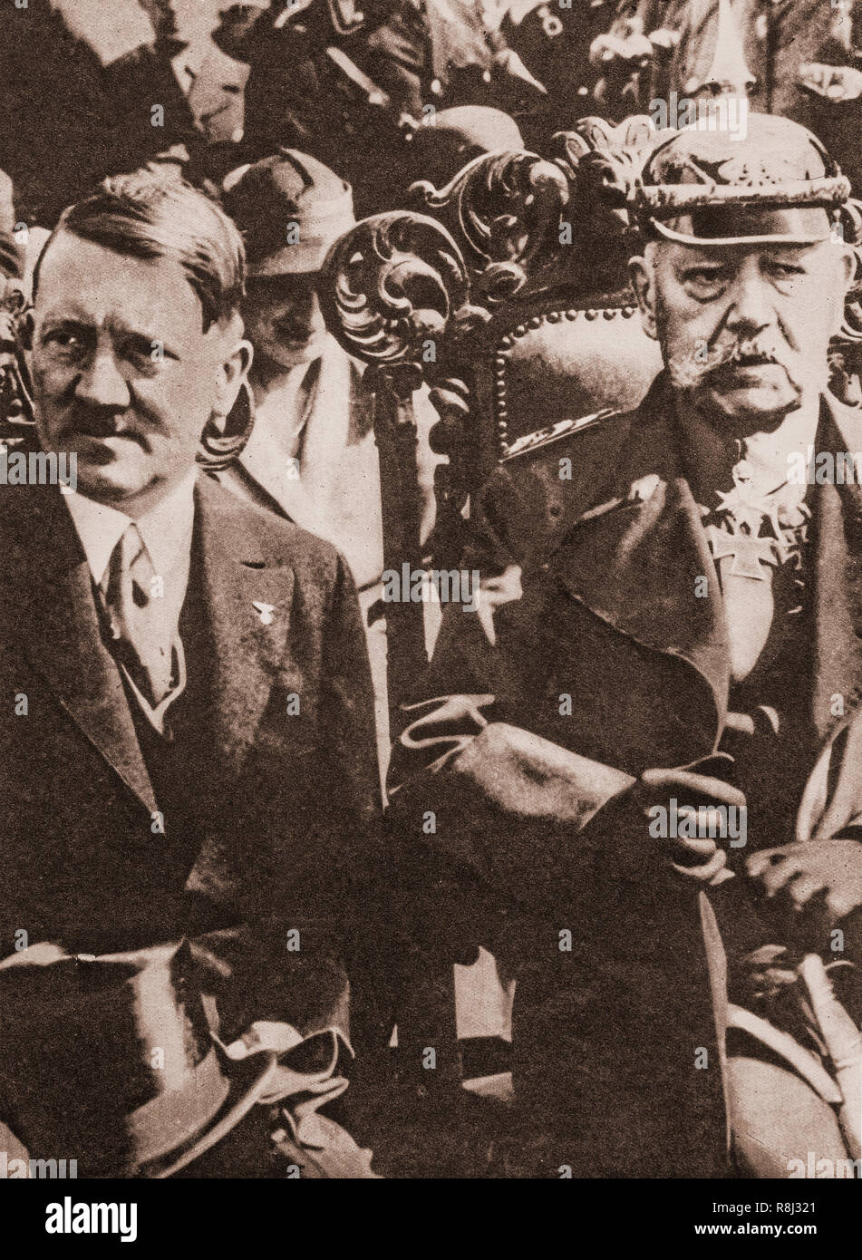 President Paul von Hindenburg and Adolf Hitler on January 30th, 1933, when the latter was appointed chancellor in a coalition government. Hitler and the Nazi Party won 37 per cent of the total vote in the 1932 German election which made it the largest party in the Reichstag. In March the Reichstag conferred dictatorial powers on him for four years, but the following year, Hitler eliminated about a hundred rivals; in August 1934 Hitler was proclaimed Führer of the German Reich, head of state and commander of the armed forces, giving him dictatorial power over the country. - Stock Image