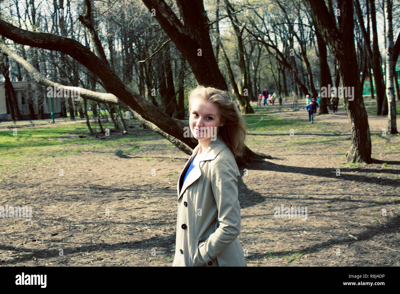 young pretty blonde girl enjoing spring nature in park, lifestyl - Stock Image