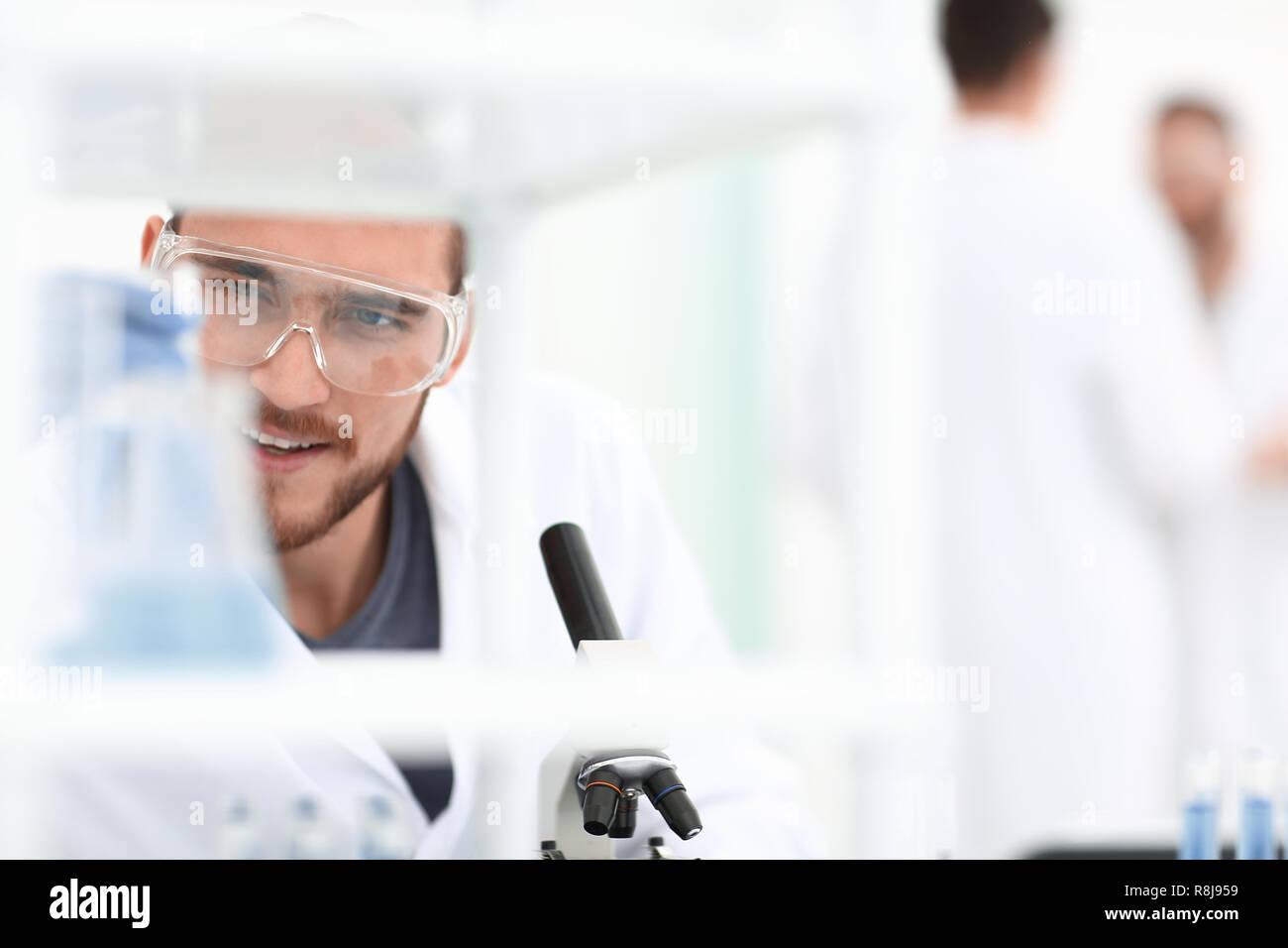 closeup.male chemist on blurred background laboratory - Stock Image