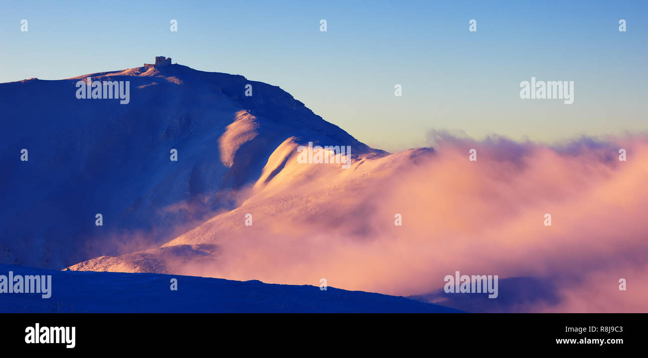 Winter landscape with a colorful sunrise in the mountains. Carpathians, Ukraine Stock Photo