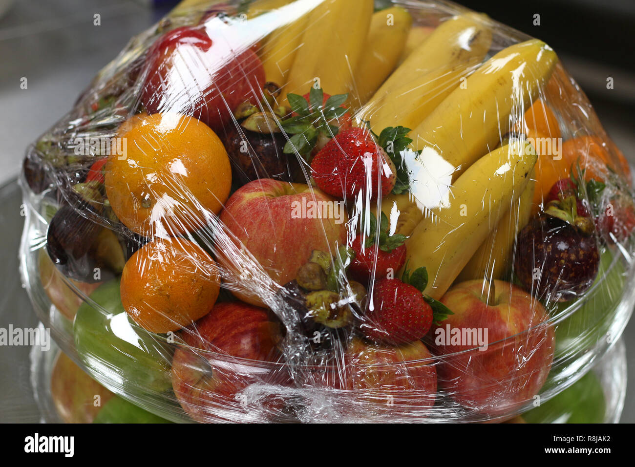 tropical fresh fruits warped in plastic - Stock Image