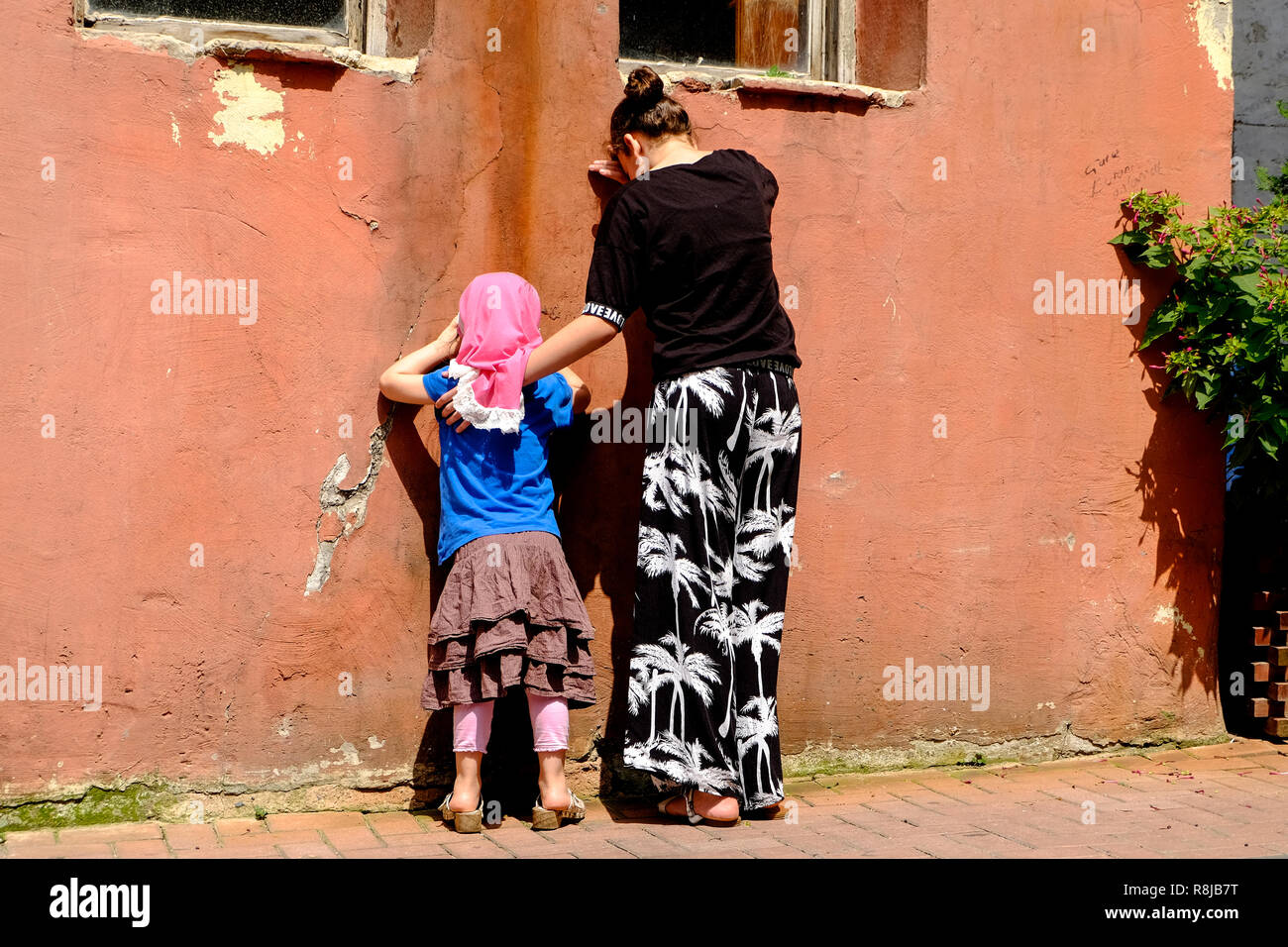 Kids playing hide and seek - Stock Image