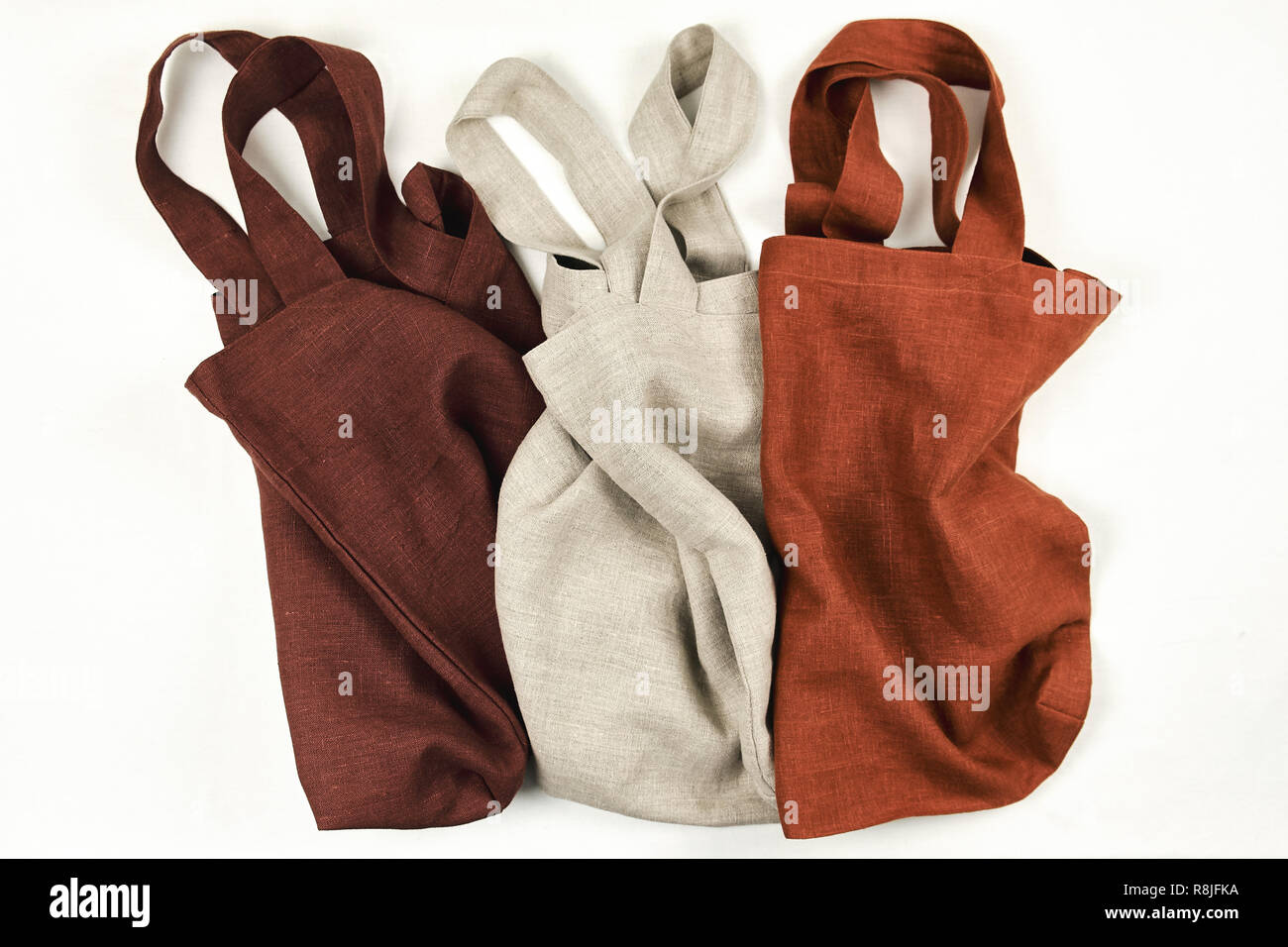 Eco Linen or Cotton Bag Various Color Collection. Organic Zero Waste Package for Keeping Vegetables Fresh and Healthy at Home. Blank Reusable Natural  - Stock Image