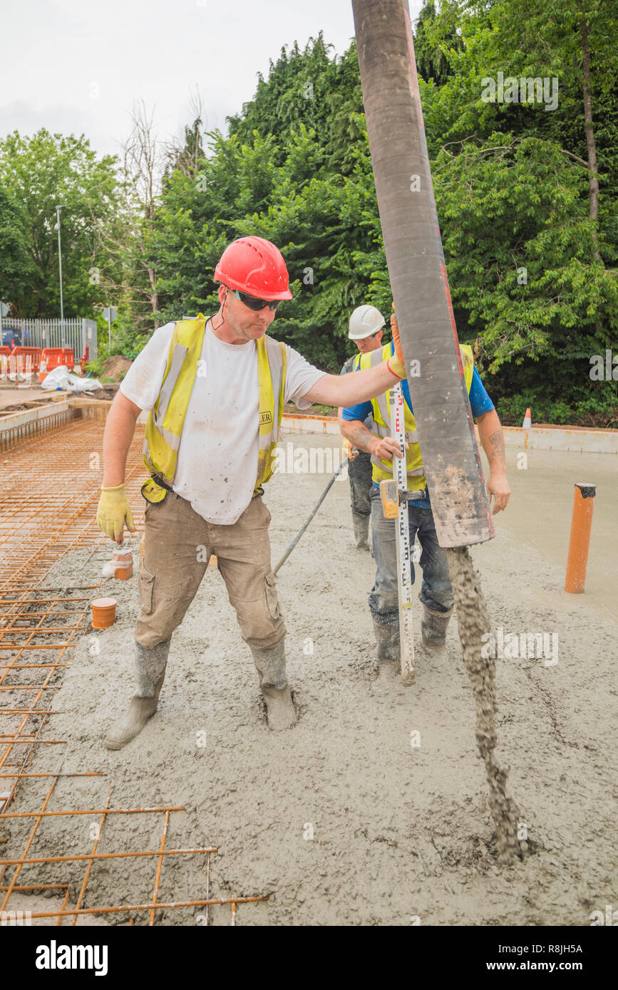 Pouring the concrete slab at Maggies Cardiff Stock Photo