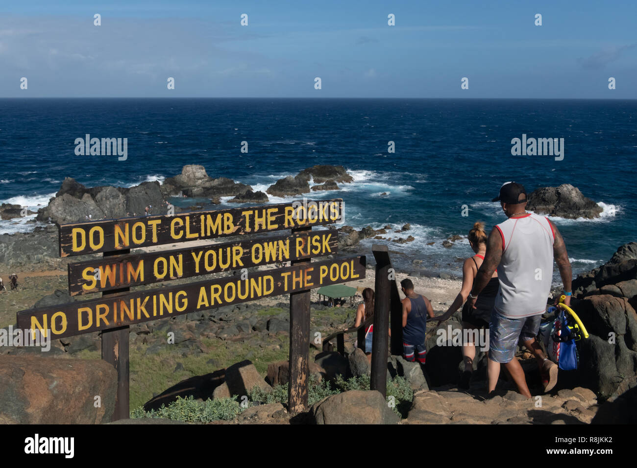 Natural pool Aruba - Conchi Aruba - warning signs for snorkelers and tourists visiting a popular tourist attraction in Arikok National Park - Stock Image