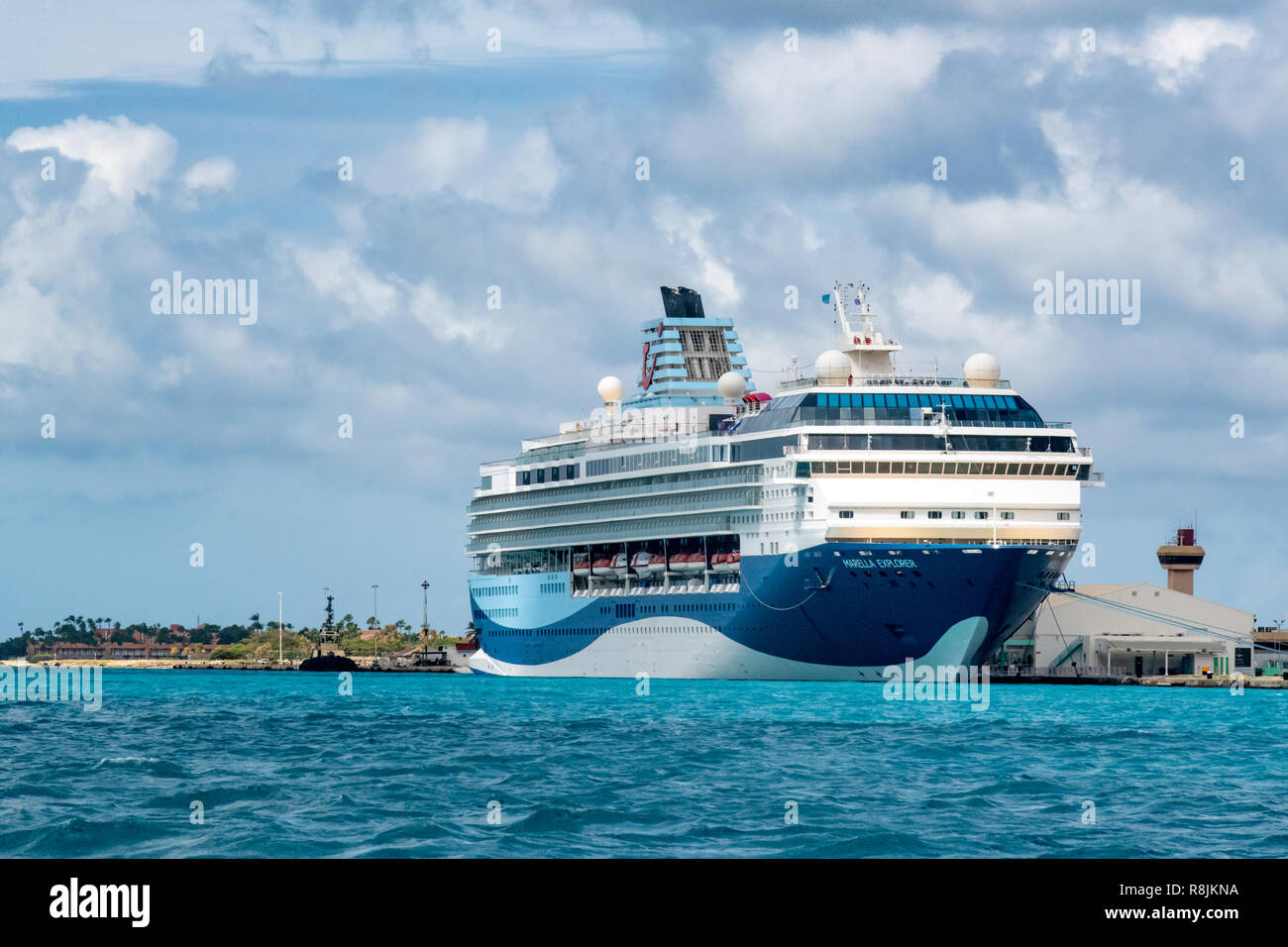 Cruise ship in Caribbean island of Aruba - cruise port with two docked cruise ships in the port of Oranjestad wait for cruise vacation passengers - Stock Image