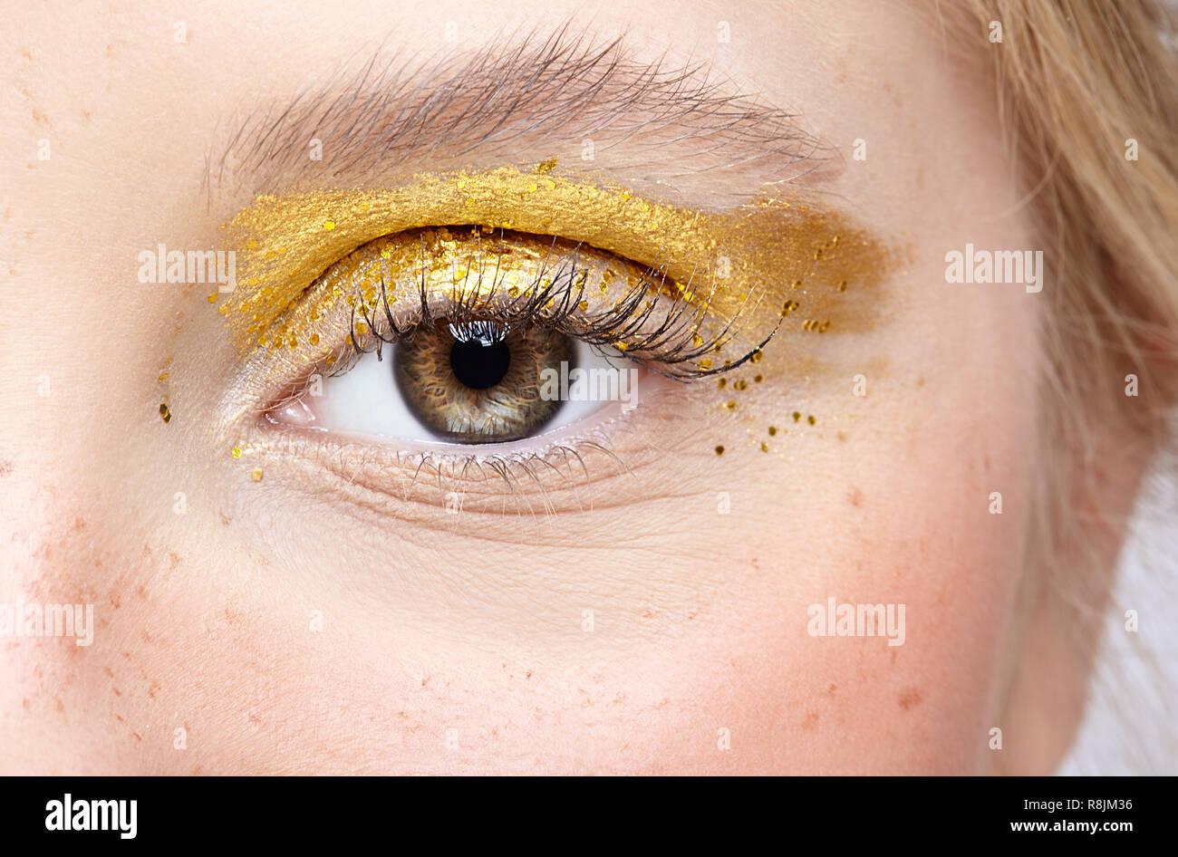 a1f8118e61e Closeup macro shot of human female eye. Woman with unusual glitter glitzy  vogue face beauty