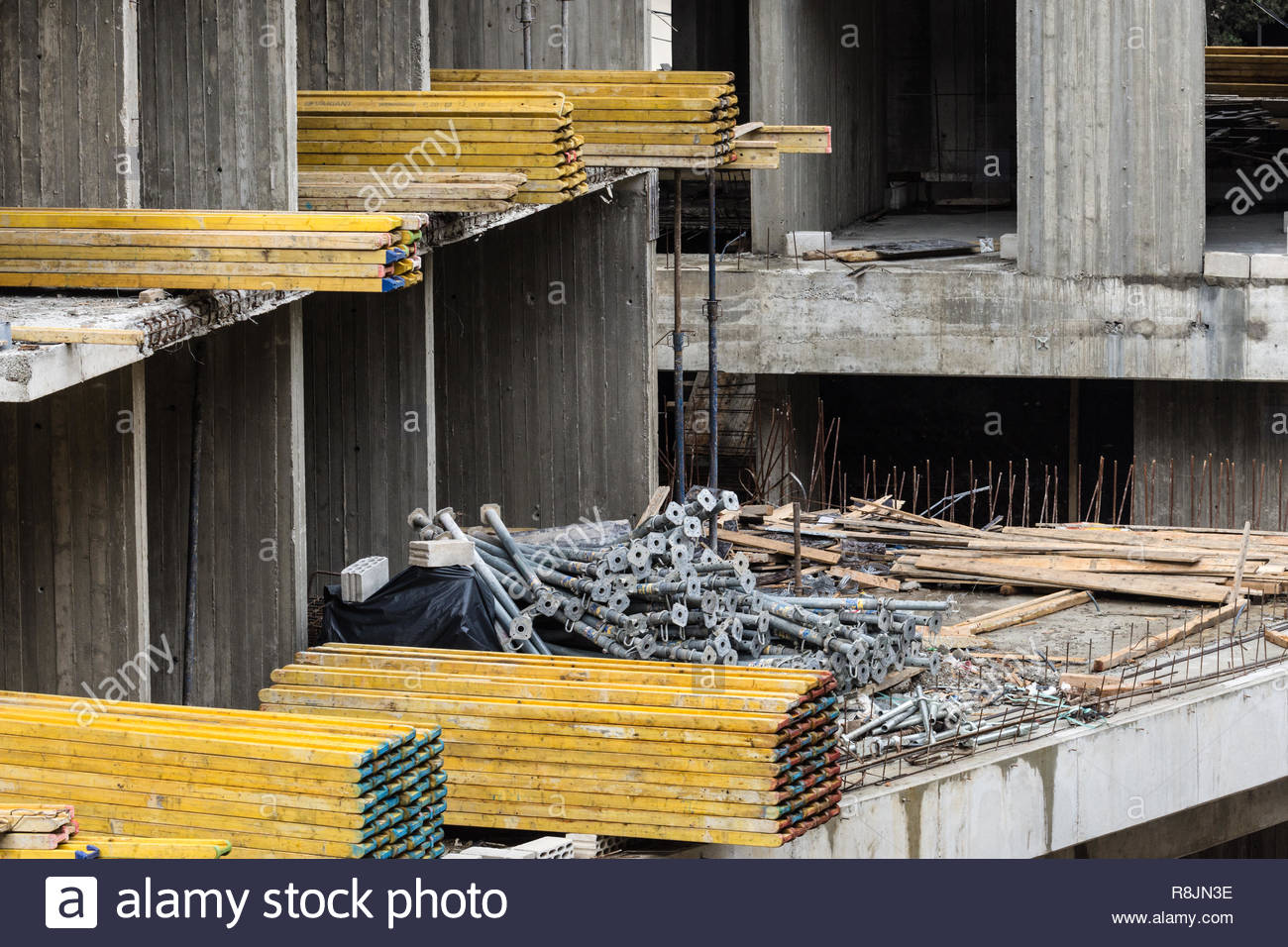 Steel props and wooden joists left in a building under construction, Lebanon - Stock Image