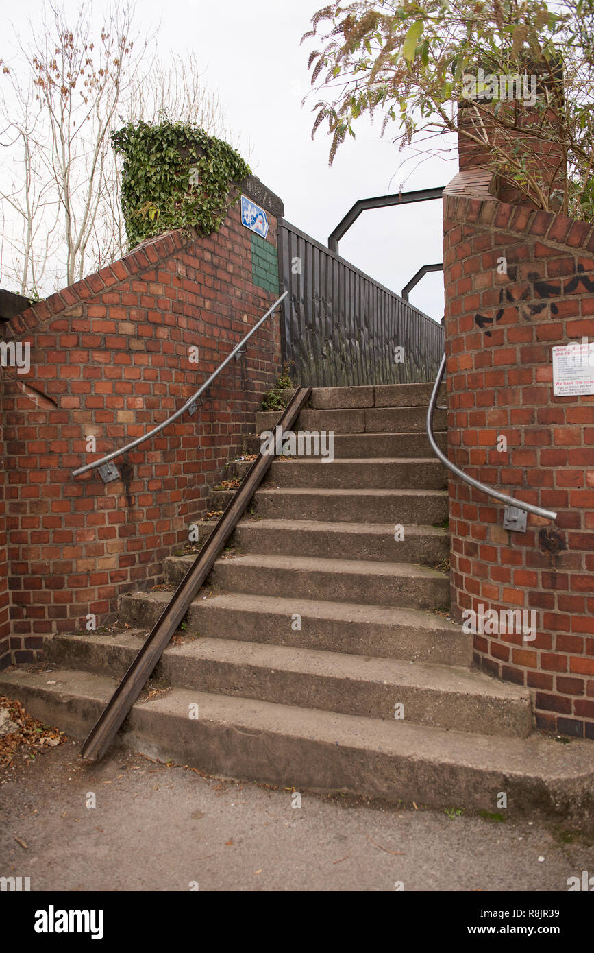 Steps with a cycle rail at a footbridge in York, England - Stock Image