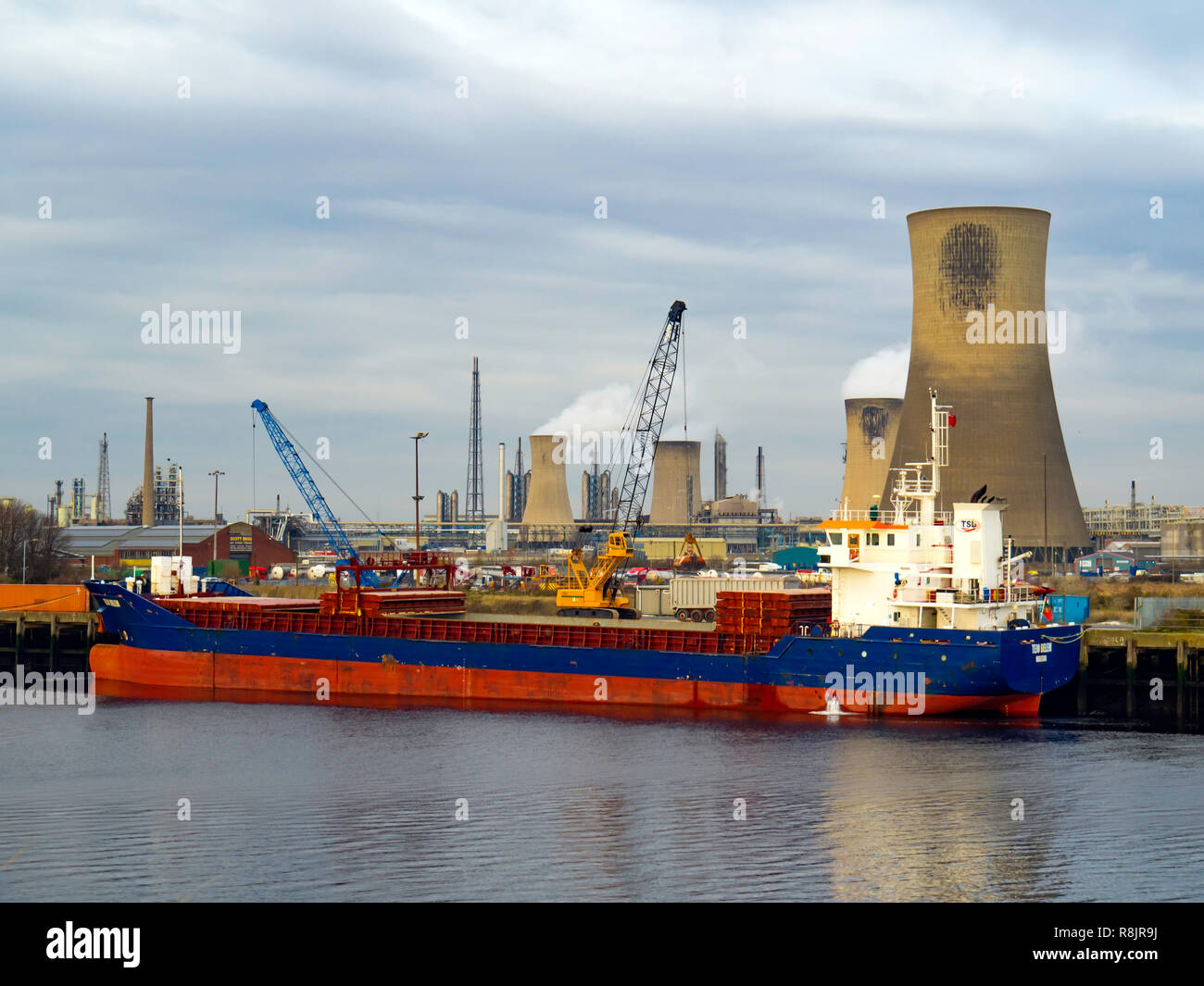 Portugese Flag General Cargo ship TEJO BELEM IMO 9368417 moored at Bamlets Wharf at Billingham River Tees dischsrging Cargo using a grab crane. - Stock Image