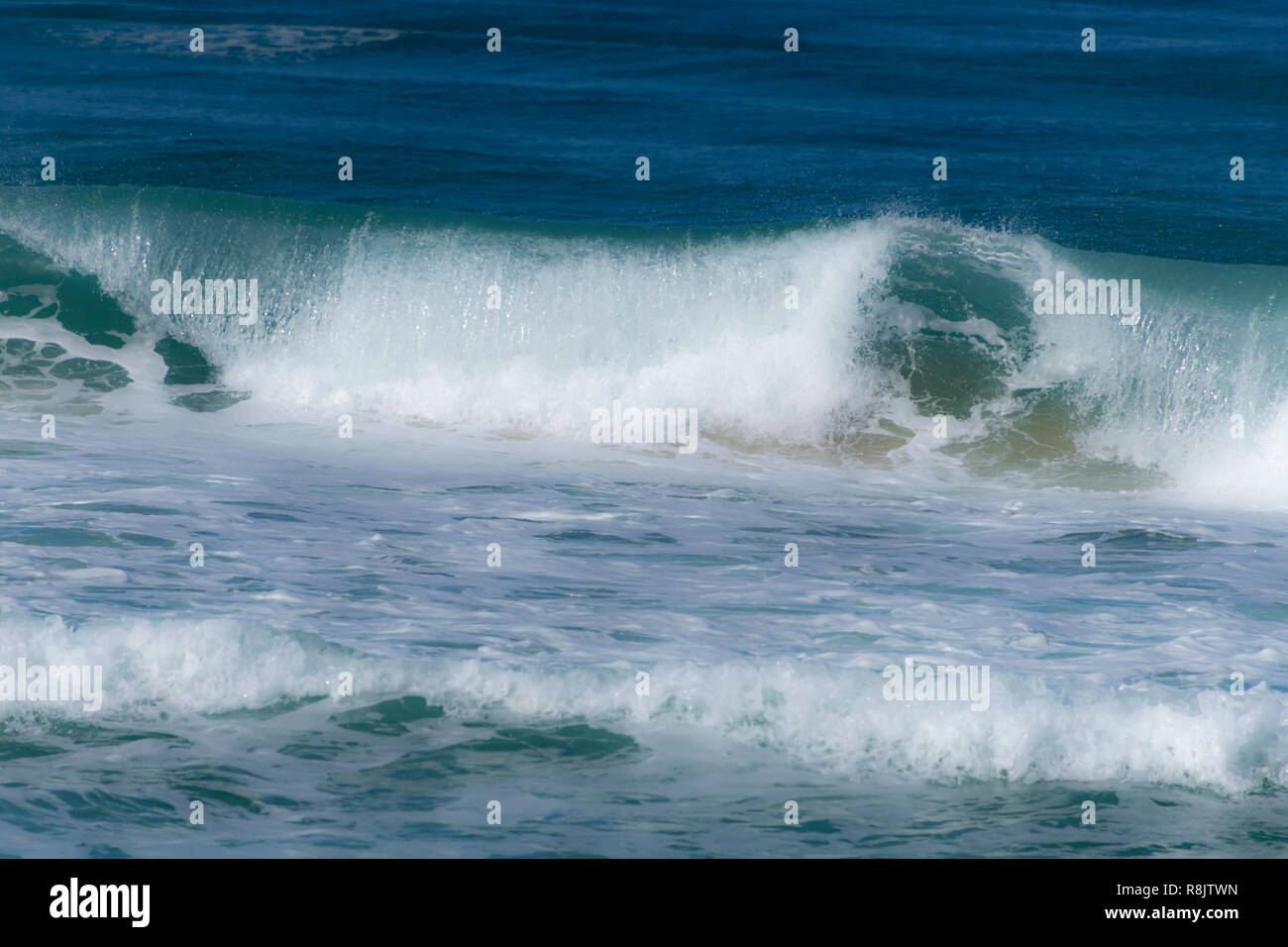 Foam waves running onto the shore. Mediterranean Sea. Israel - Stock Image