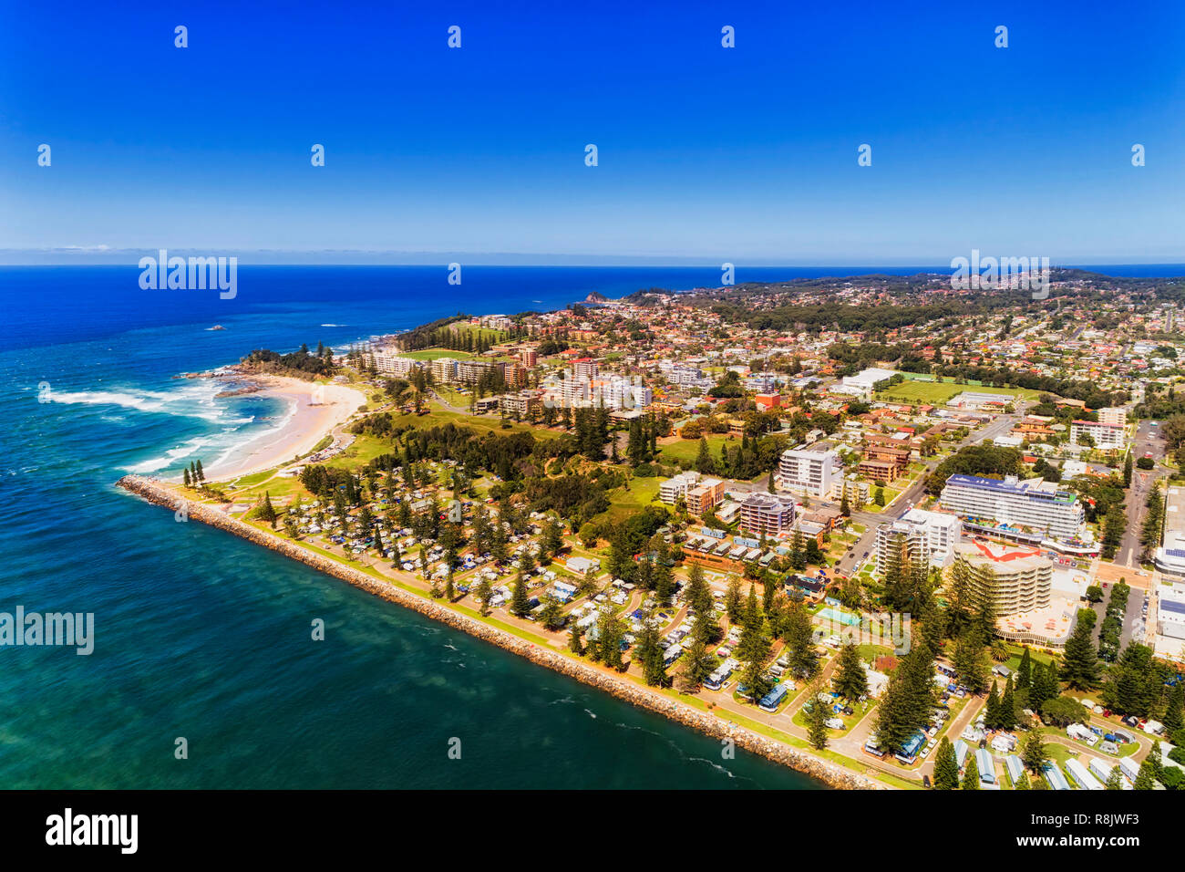 Waterfront of Port Macquarie town on Australian Middle north coast of Pacific ocean along Hastings river on a sunny summer day in aerial view. Stock Photo