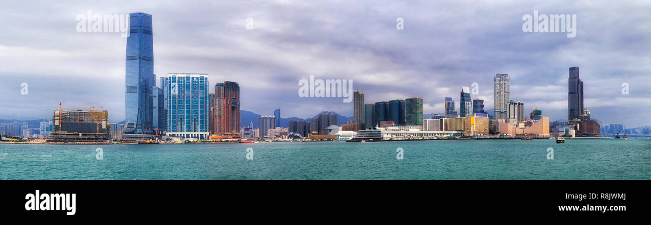 Daytime panorama of Kowloon and Thim Sha Tsui waterfront of Hong Kong across Victoria harbour around Star ferry pier and cultural centre with promenad - Stock Image