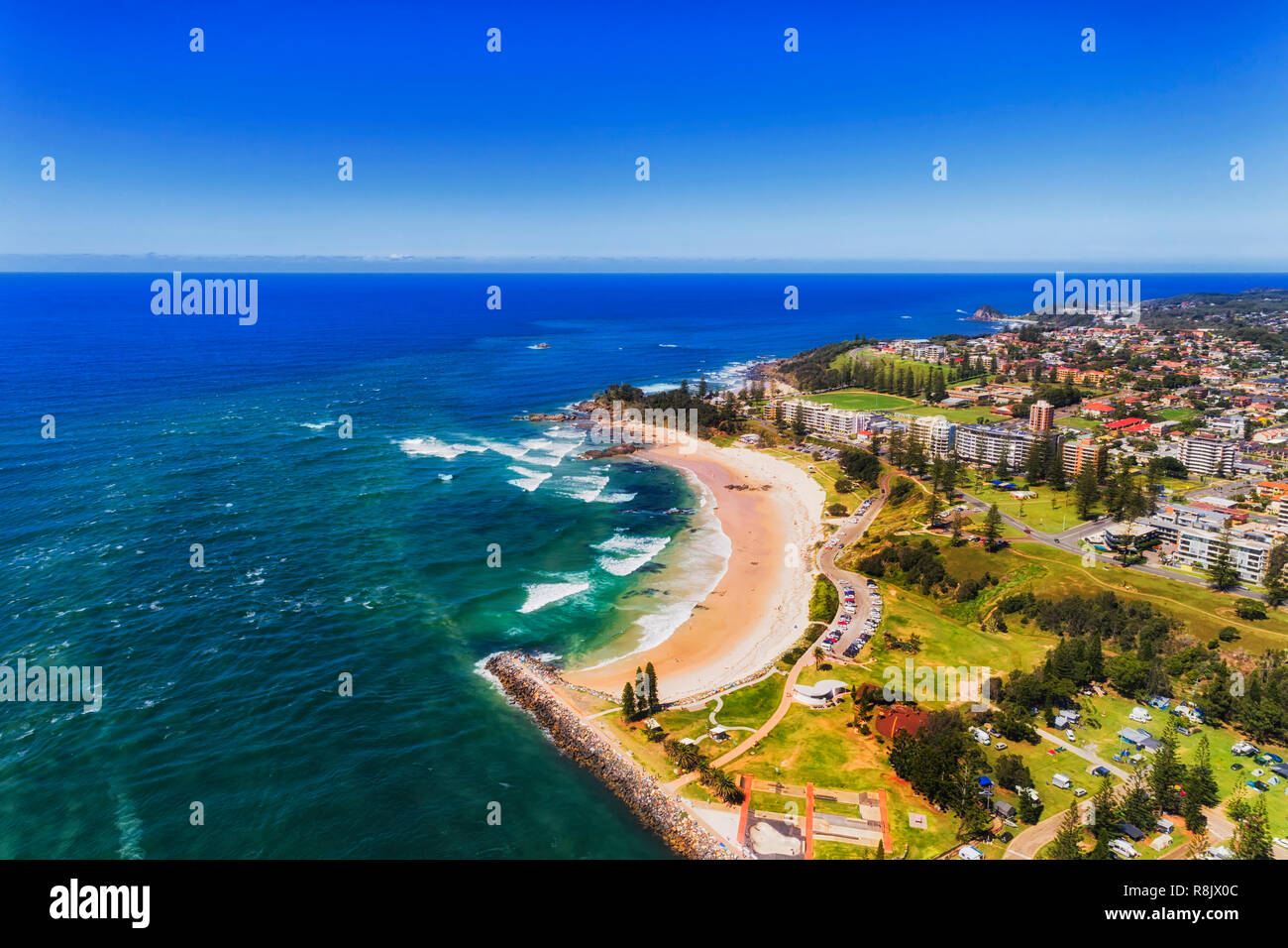 Port Macquarie on Australian NSW pacific coast seen from above around river delta and local beach adjusted to caravan park for tourists. Stock Photo