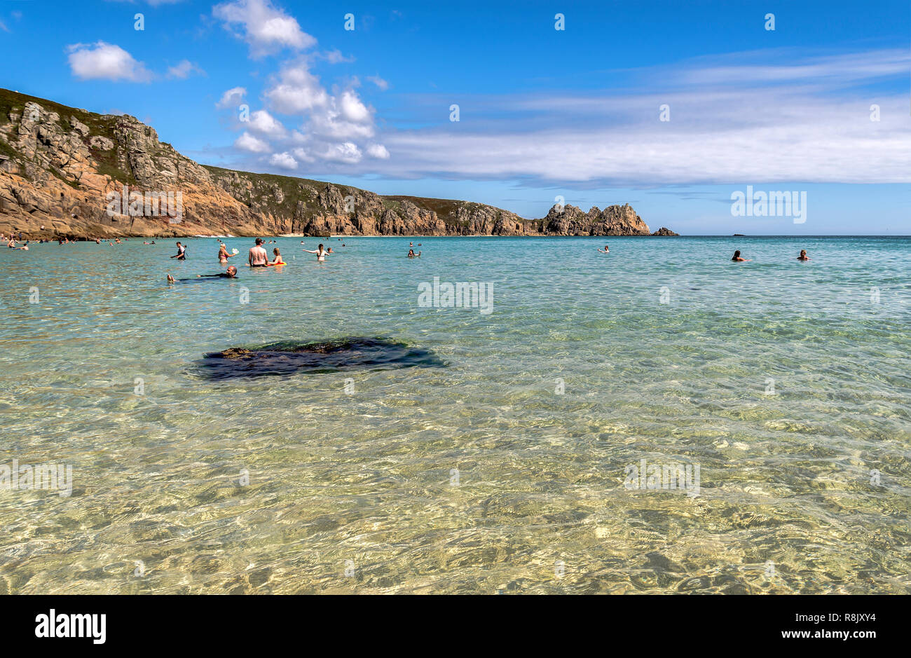 Swimming in clear water Porthcurno beach West Cornwall UK - Stock Image