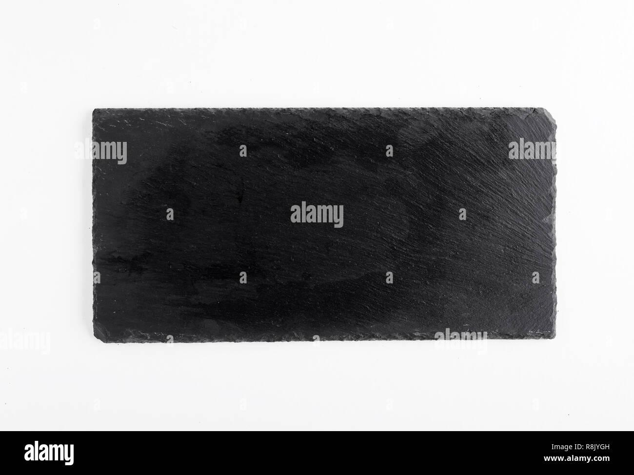 Black slate board isolated on white - Stock Image