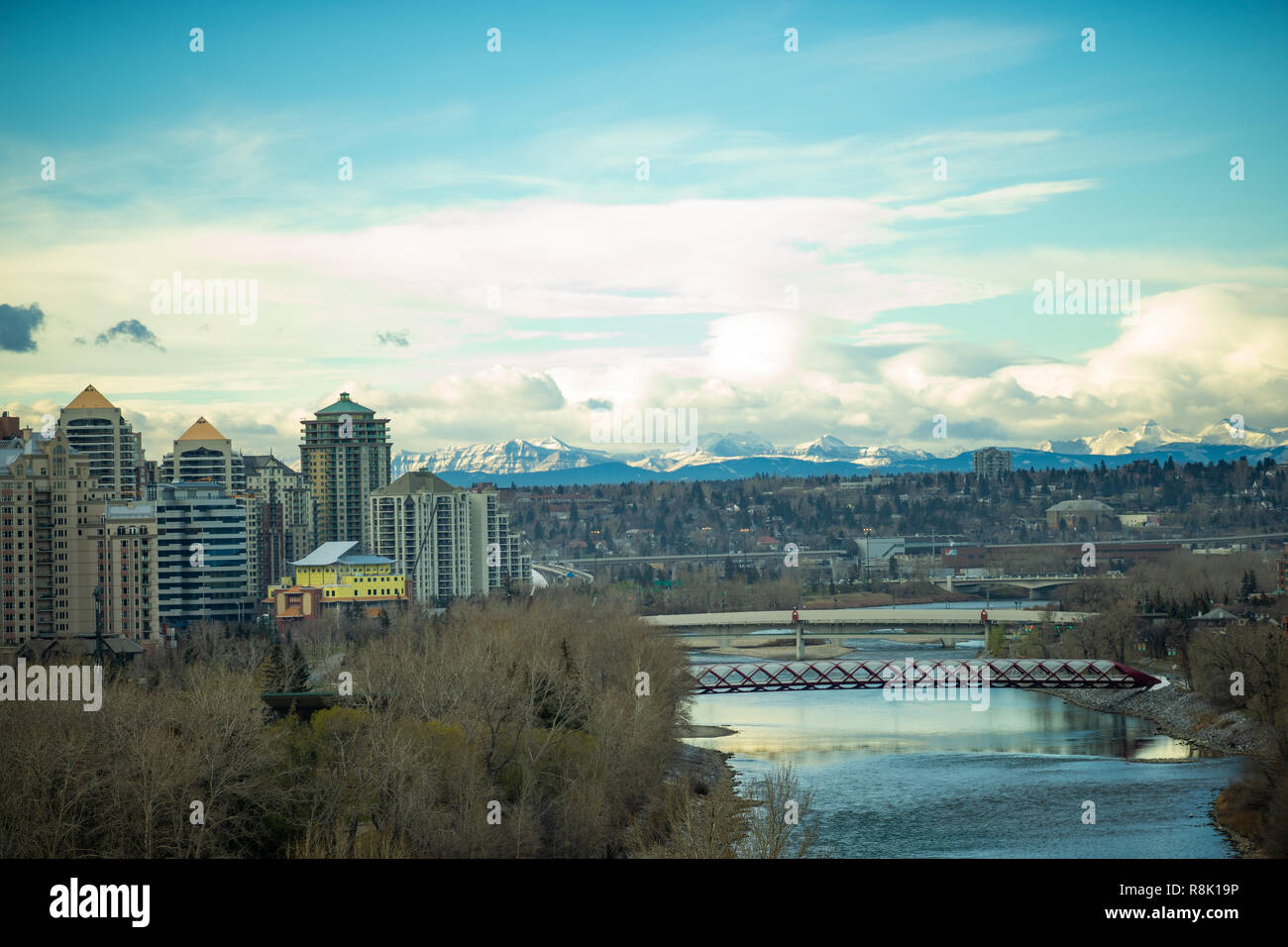 View of downtown Calgary with bridges and the rockies - Stock Image