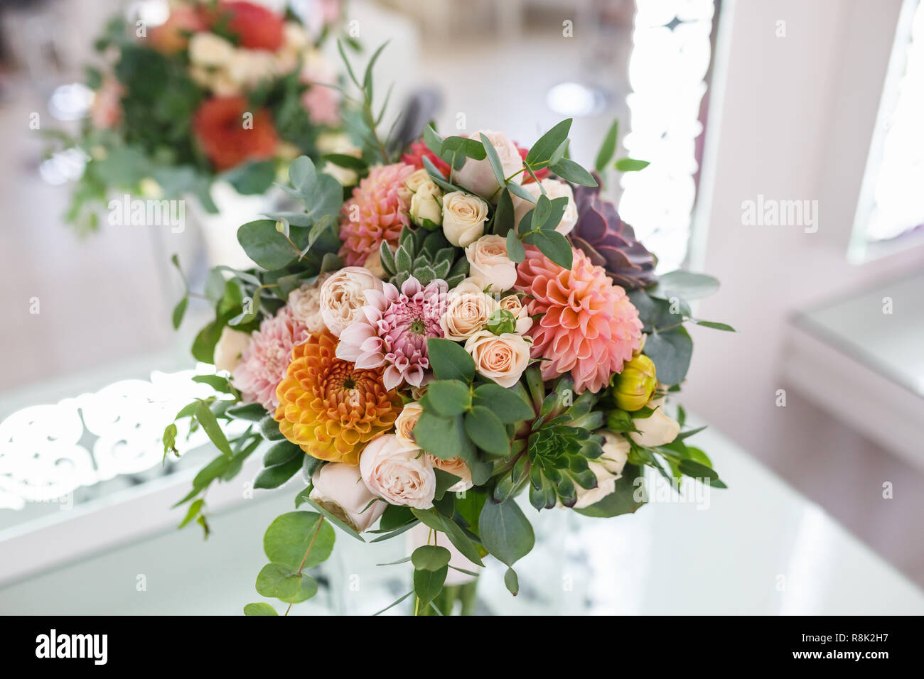 bright wedding bouquet of summer dahlias and roses Stock Photo