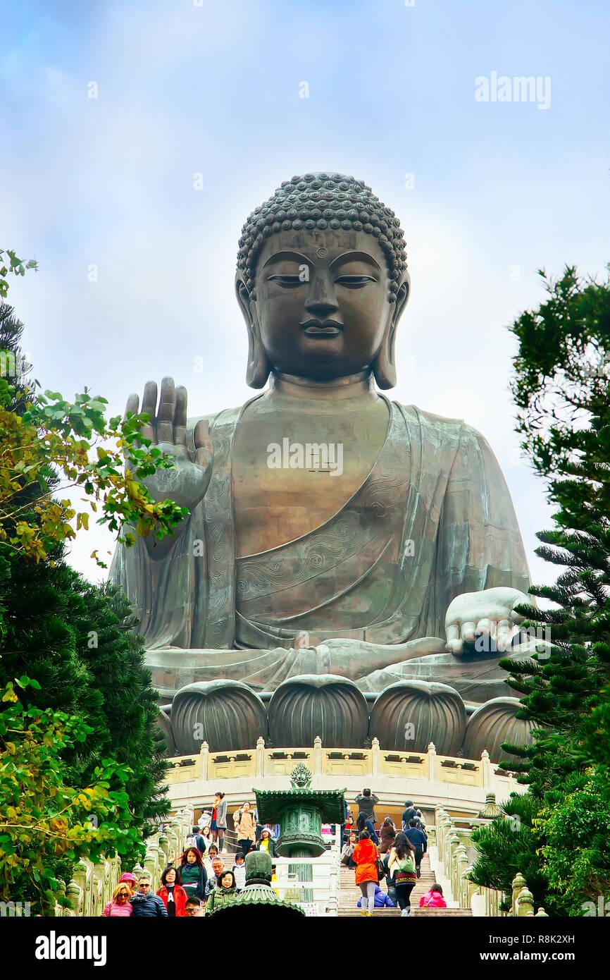 Hong Kong, China  - January, 9, 2014: Big Buddha, staircase and people going to statue Lantau Island, Hong Kong - Stock Image