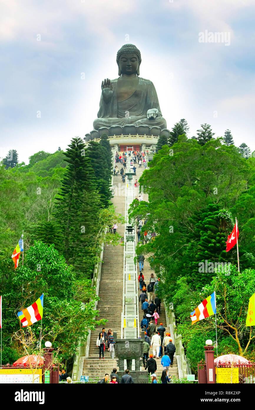 Hong Kong, China - January 9, 2014: Big Buddha, staircase and people going to statue Lantau Island, Hong Kong - Stock Image