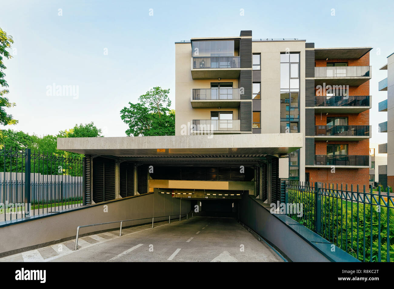 Modern residential apartment building with garage. House and ...