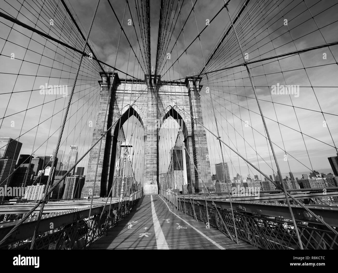 Black and white picture of the brooklyn bridge upper walk deck with