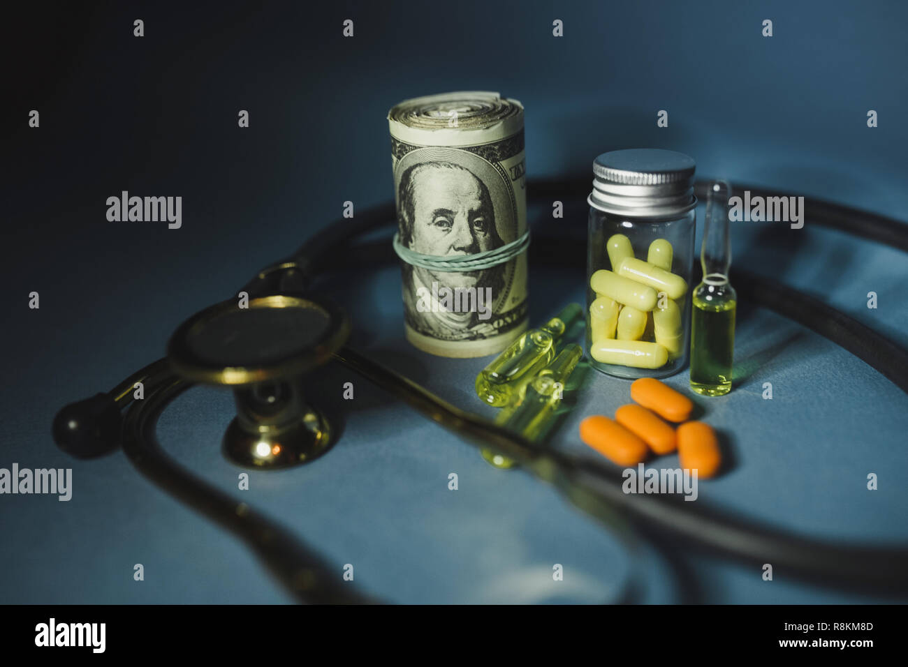 Medicine pills or capsules with money, dollar. Medical or pharmacy prescription for health. Business, finance concept. Cost of the healthy life. Bottl - Stock Image