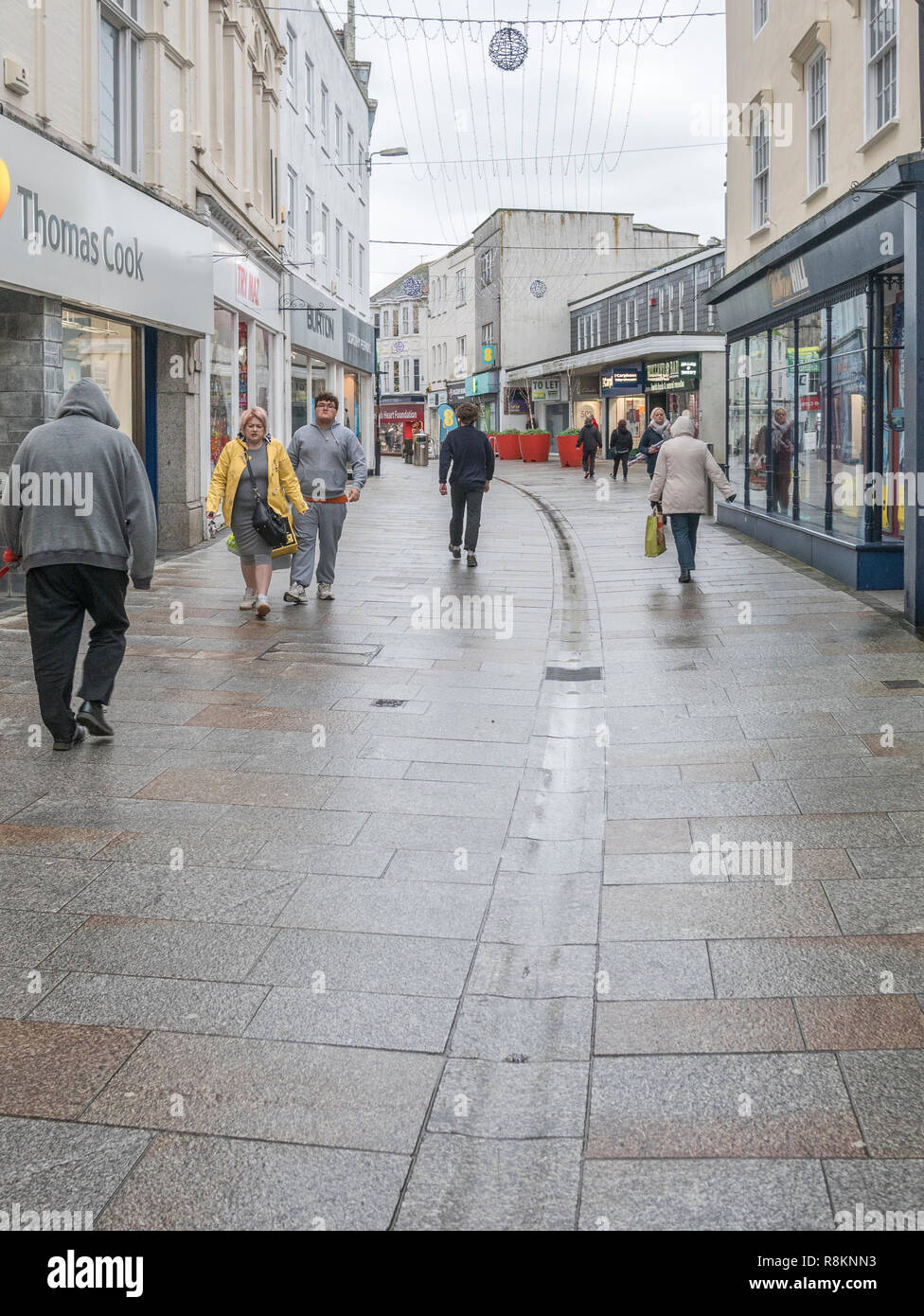 Almost deserted Fore Street in St. Austell - a retail shopping zone at Christmas 2018. Metaphor for death of the high street, poor retail sales. - Stock Image