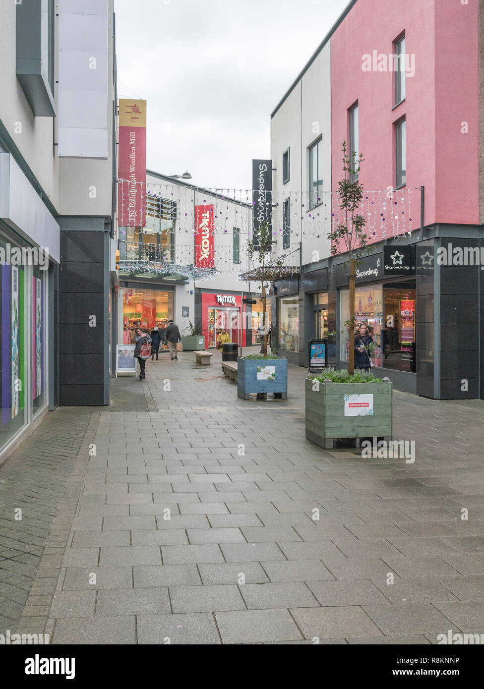 Almost deserted Fore Street in St. Austell, Cornwall - a retail shopping zone at Christmas 2018. Metaphor death of the high street, poor retail sales. - Stock Image