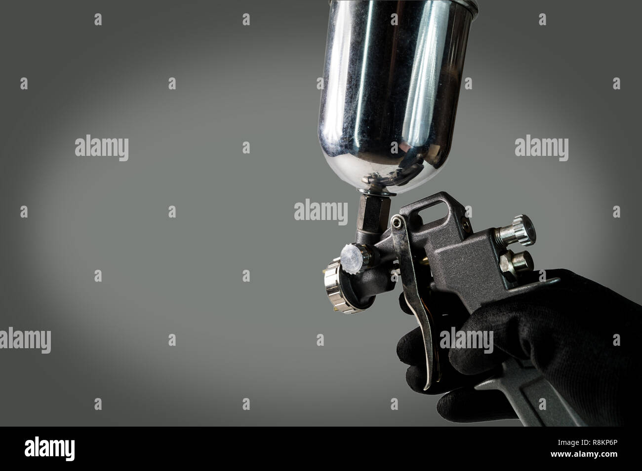 a painter working with a airbrush gun - isolated - Stock Image