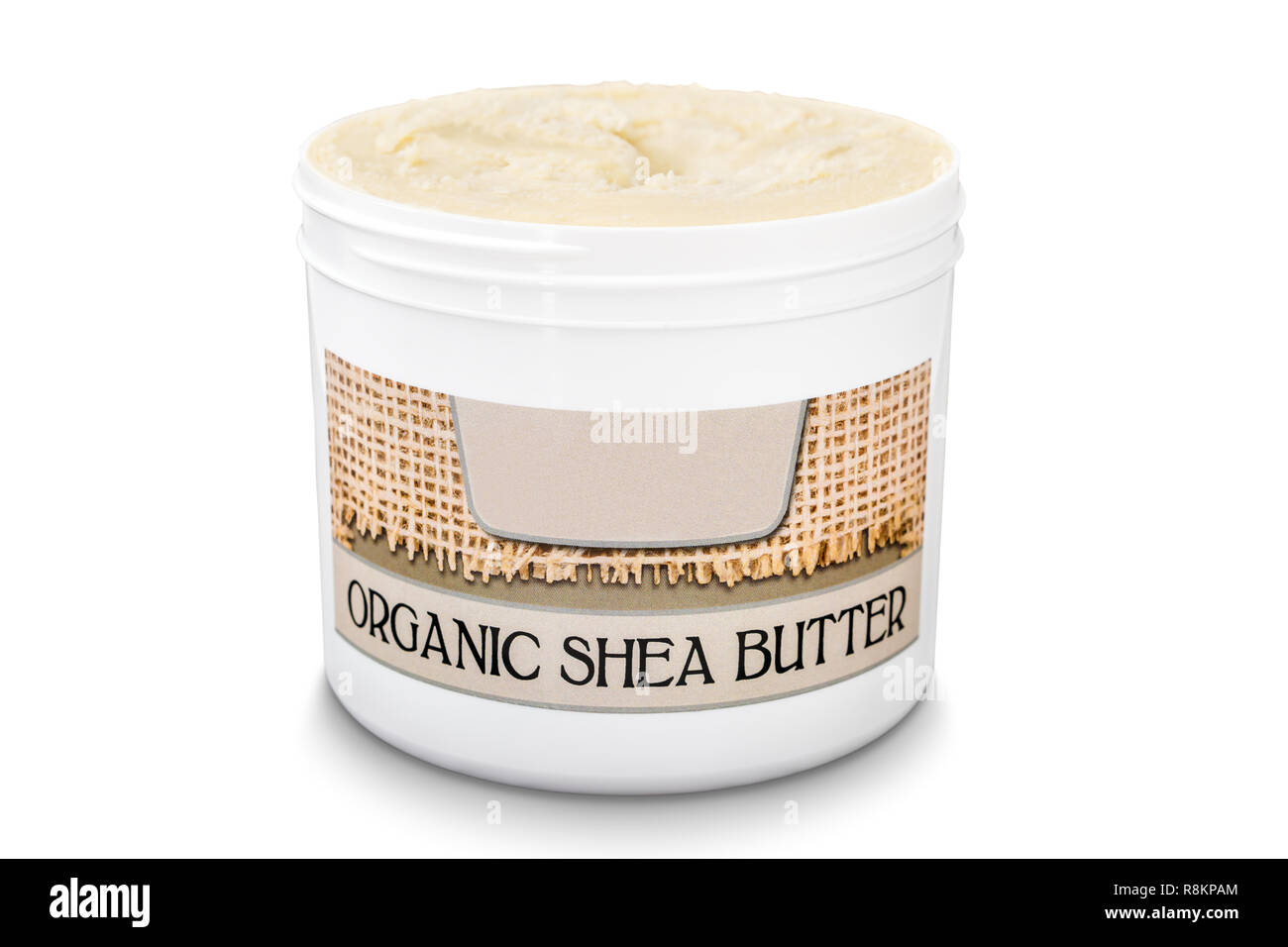 Jar filled with organic pure shea butter isolated on white background Stock Photo