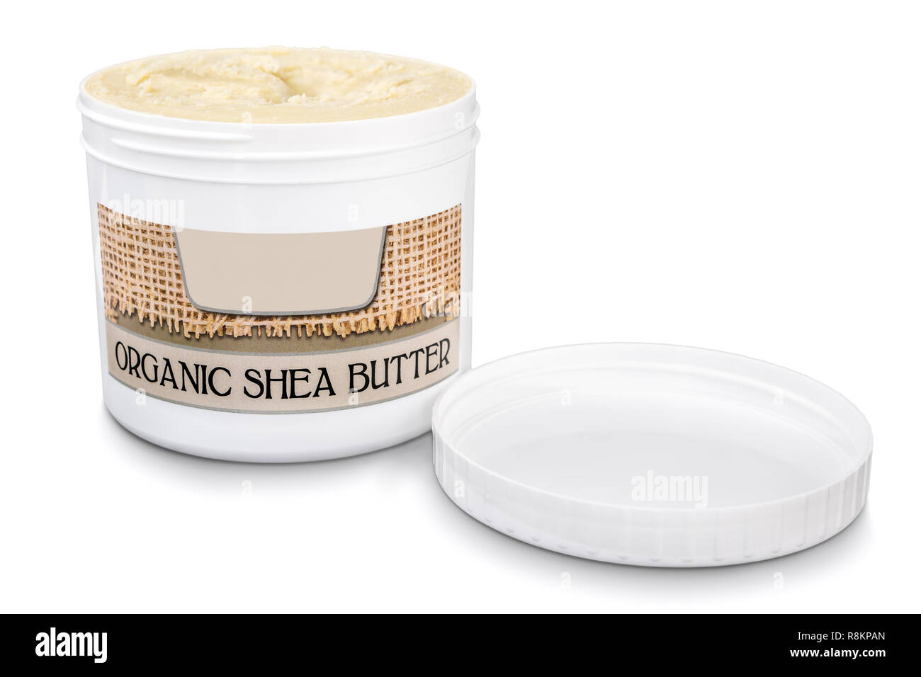 Jar filled with organic pure shea butter with lid on side isolated on white background Stock Photo