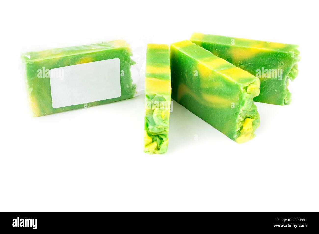 Handmade green and yellow artisan jojoba soap bars on white background - Stock Image