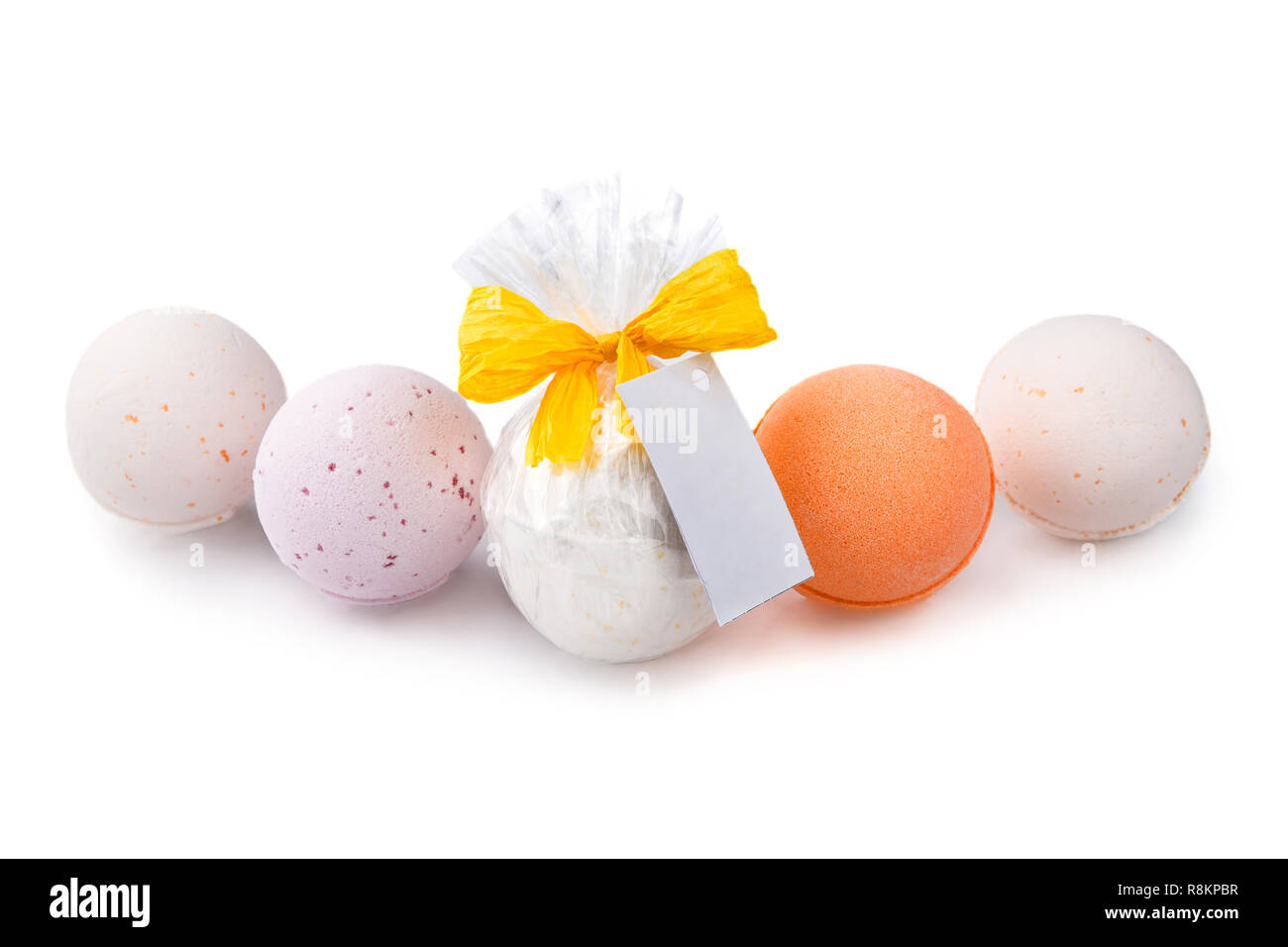 Aromatherapy colorful bath bombs gift wrapped isolated on white background - Stock Image
