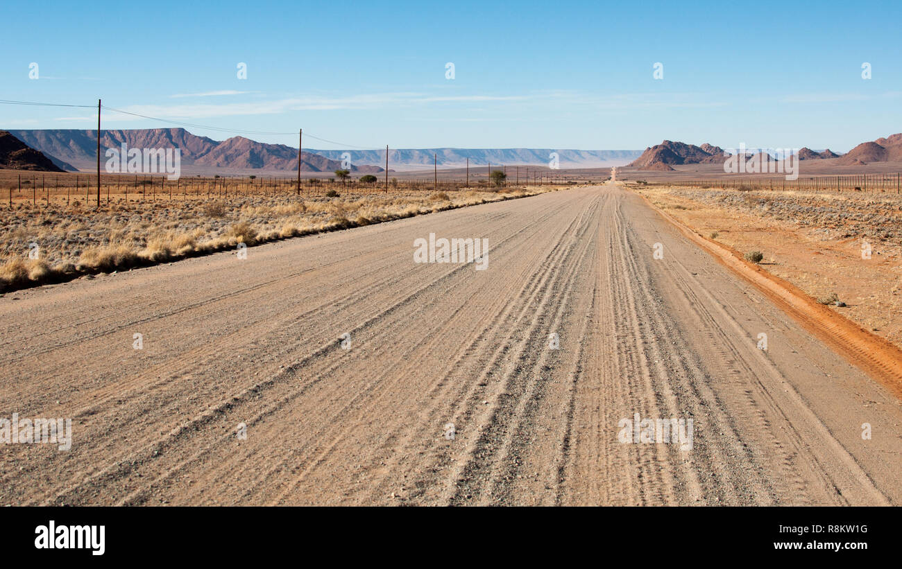 Endless sand road in Namibia - Stock Image