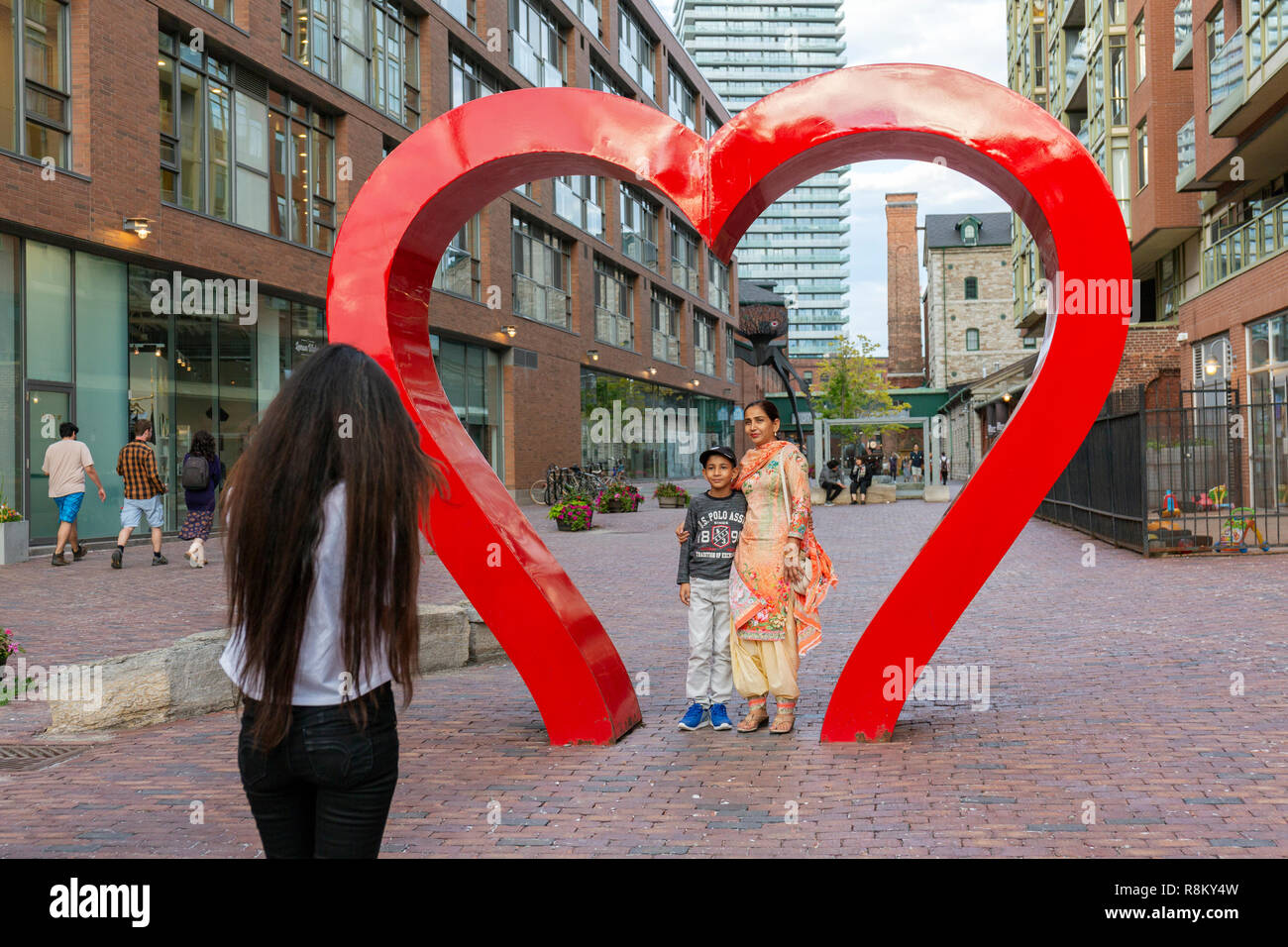 Canada, Province of Ontario, Toronto, Distillery Historic District, former home to the Gooderham and Worts Distillery, a pedestrian district dedicated to art, culture, commerce and entertainment, giant heart, installation called Under the Mistletoe - Stock Image
