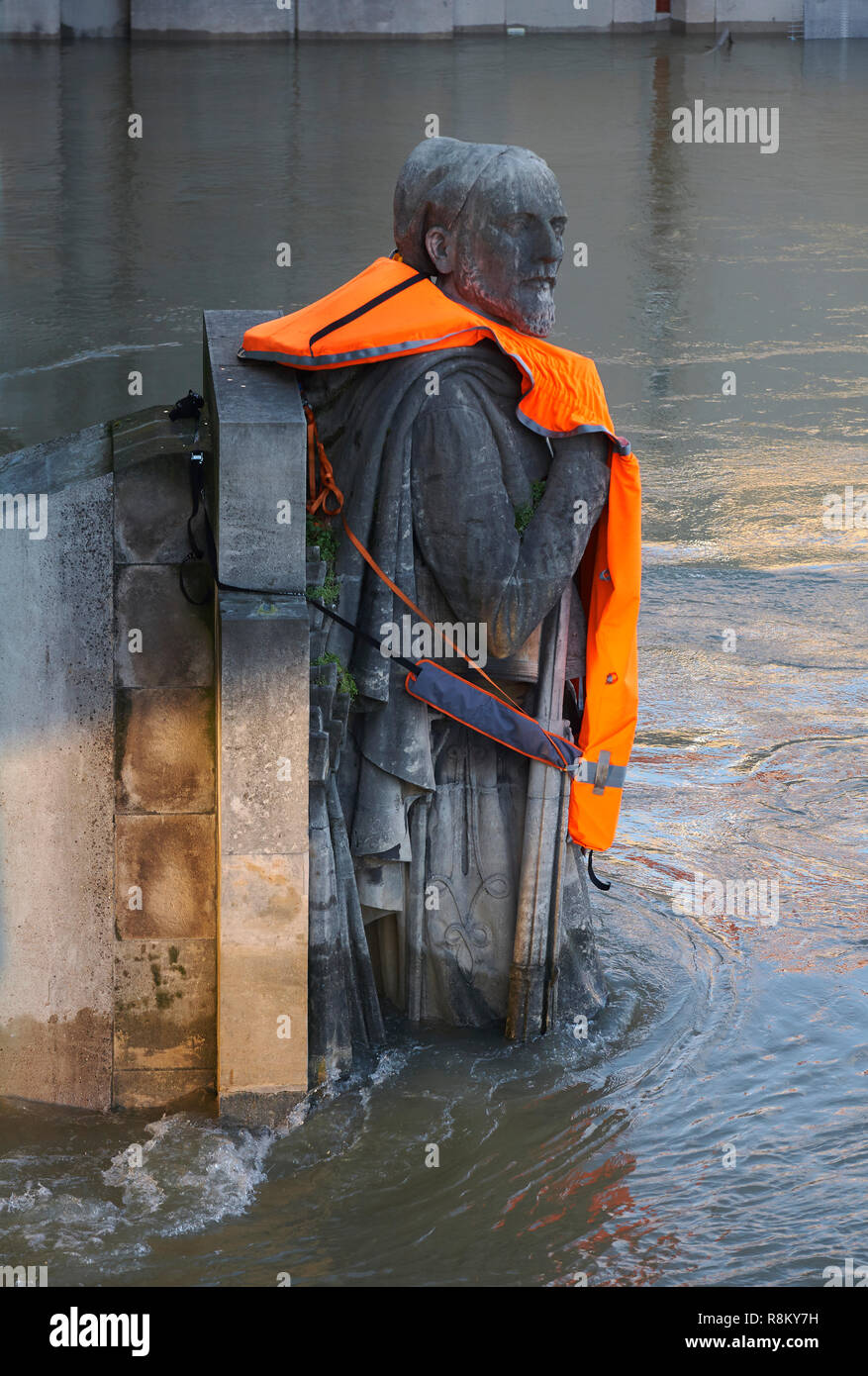 France, Paris, area listed as World Heritage by UNESCO, Seine Flood in January 2018, Snow covered Alma Bridge Zouave wearing a life jacket put by activists of Good Planet foundattion prostesting against global warming - Stock Image