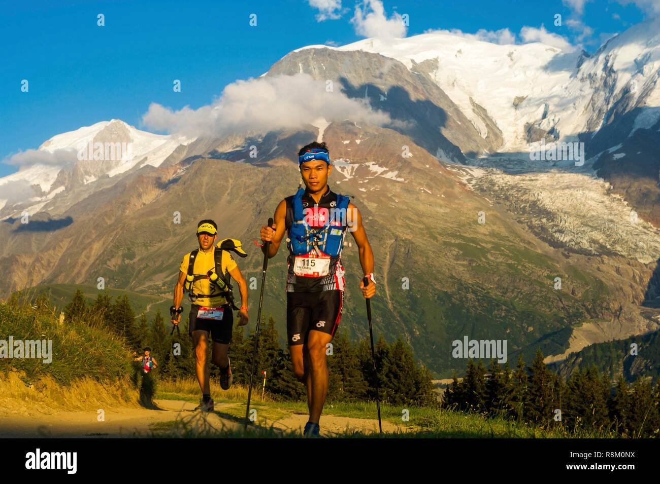 France, Haute-Savoie, St-Gervais-les-Bains, trail race of UTMB, crossing of the col de Voza, at the foot of the Aiguille du Goûter and Mt Blanc in the back and Mont Blanc du Tacul on the left - Stock Image