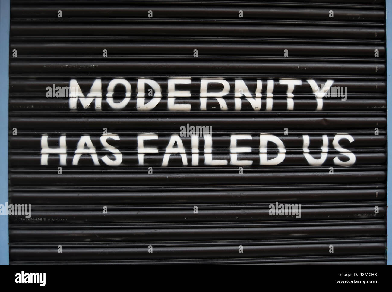 modernity has failed us, lyric from the band the 1975 used on the shutters of  banquet records, a record shop in kingston upon thames, surrey, england - Stock Image