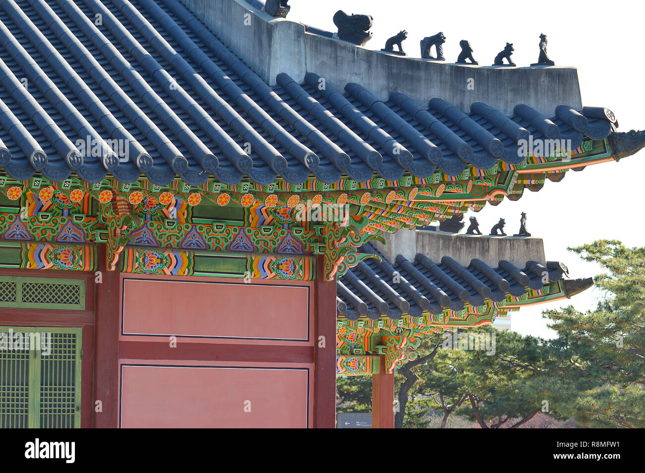 Hipped roofs, tiles, painted decorations, and hermits, monks and monsters on the roof as guardians, typical Korean palatial architecture at Changdeokg - Stock Image